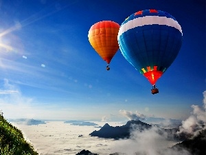 rays, Mountains, color, Balloons, sun, clouds