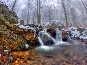 Fog, rocks, waterfall